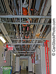 Utility cables and pipes - Hallway with a ceiling full of ...