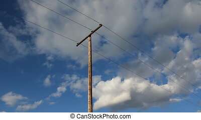 Utility pole and time lapse clouds.