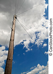 utility pole and wires under a cloudy sky
