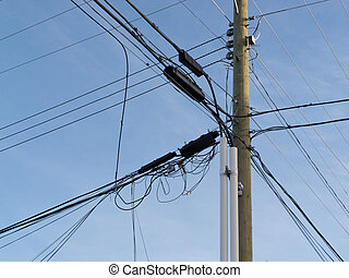 Utility pole confusing power cable phone line mess