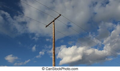 Utility pole with clouds. Real time shot. Alberta, Canada.