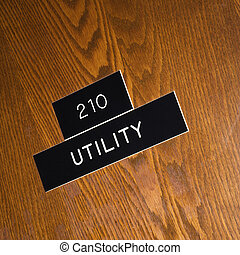 Utility sign. - Shot of utility sign on wooden door.