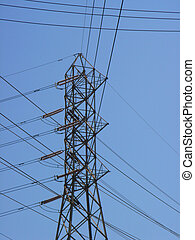 utility tower and power lines with blue sky background