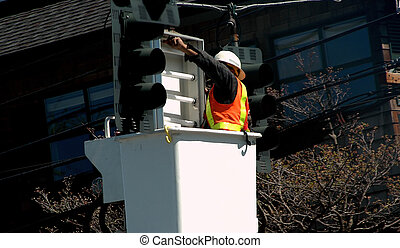 Utility worker. - Utility worker repairing a traffic signal ...