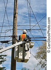 Utility Workman - A utility workman on a lift to do repair ...