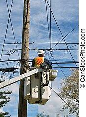 Utility Workman - A utility workman on a lift to do repair...
