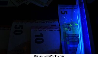 UV light using for checking euro banknotes. Counterfeit...