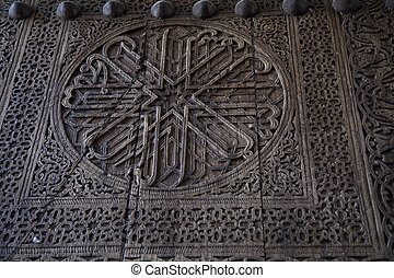 Uzbekistan, an ancient wooden door decorated