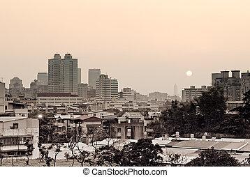 város, napnyugta
