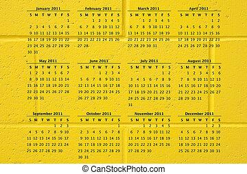 vägg, gul fond, kalender, 2011, tegelsten