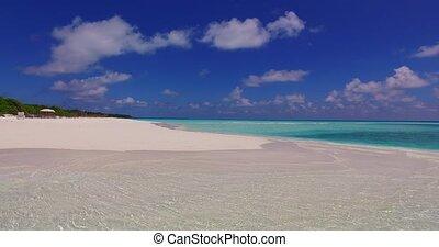 v07157 Maldives white sandy beach clouds on sunny tropical...