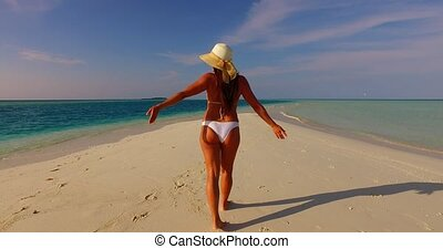 v07843 Maldives white sandy beach 1 person young beautiful...