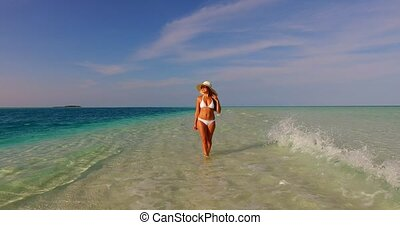 v07848 Maldives white sandy beach 1 person young beautiful...
