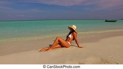 v07865 Maldives white sandy beach 1 person young beautiful...