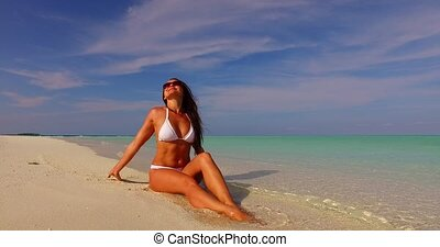 v07889 Maldives white sandy beach 1 person young beautiful...