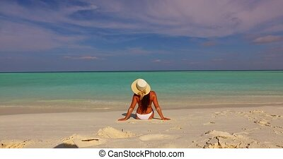 v07905 Maldives white sandy beach 1 person young beautiful...