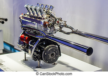 V8 sport engine with polished exhaust and throttles