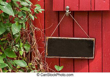vacío, signo metal, delante de, un, rojo, pared de madera