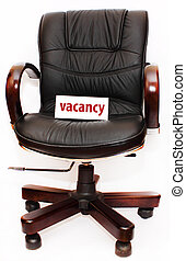 vacancy - black leather easy chair with white tablet