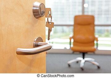 Vacancy job. Half opened door to an office. Door handle, door lock, armchair on wheels inside