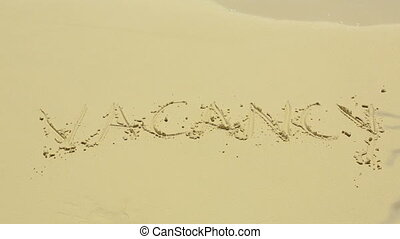 Vacancy sign on sand - Vacancy word on the sand beach on a...