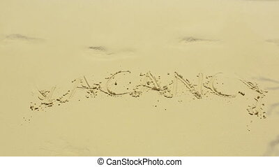 Vacancy sign on sand - Vakancy word on the sand beach on a...