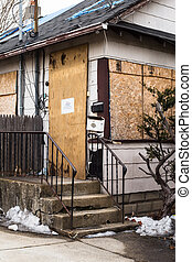 Vacant House - Vacant and boarded up house from foreclosure