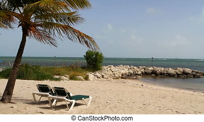 Key West Beach - Vacant recliners sit on Key West Beach,...