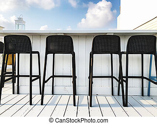 Vacant seats at the open-air bar on the roof.