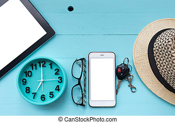 Vacation background on wood table , top view with copy space. Phone, Tablet