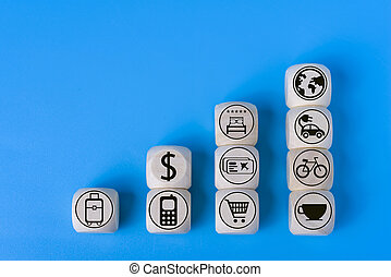 Vacation concept with icons on wooden cubes, blue background.