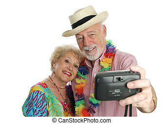 An attractive senior couple taking their picture on vacation.