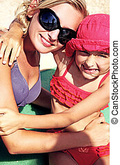 Vacation day of a cute blonde girl with sister