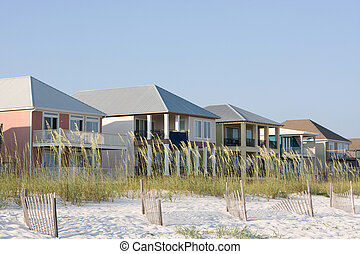 Vacation Homes - Vacation rental homes sit among the sea...