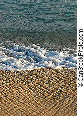 Vacation image of waves on a tropical beach