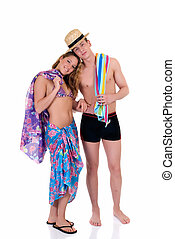 Two attractive young adults, teenage man and woman in beach clothing in love. studio shot.
