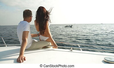 Vacation on a Speedboat - Adult Couple Relaxing on a...