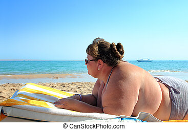 vacation - overweight woman on beach