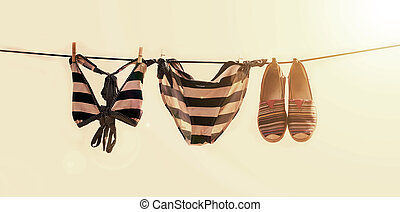 Vacation photo of swimsuit drying on the clothesline