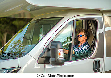 Caucasian Woman in Her 60s Driving RV Camper Van
