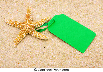 Vacation Sale - Starfish with blank tag on sand. vacation...