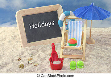 Vacation - School board and toys on a sandy beach