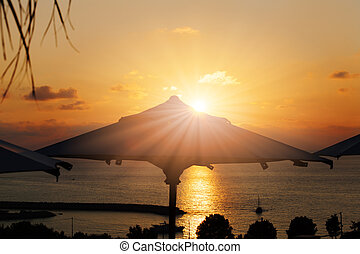 Vacation time: Amazing dawn with parasol and palms
