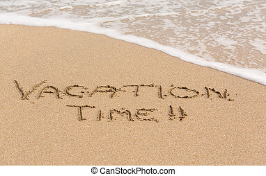 Vacation Time written in sand with sea surf - Vacation Time...