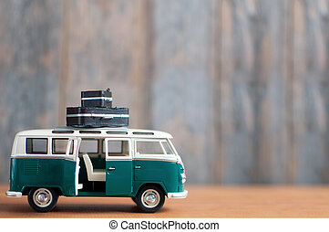 Vacation travel background - Miniature motor home with space...