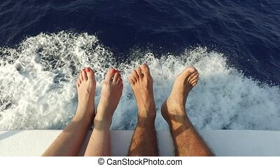 feet on deck of sailboat or yacht sailing in sea