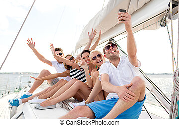 smiling friends sitting on yacht deck - vacation, travel, ...