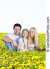 Vacation with family - Young family with a child in field