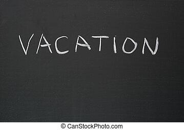Vacation Written On Blackboard