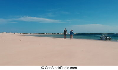 Vacationing Couple Walking and Sandy Beach in Africa